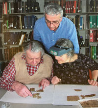 Conservator Leyla Lau-Lamb works with papyrologists Prof. Konen and the late Prof. Gagos at the University of Michigan