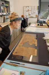 Conservator Bridget Leach working at the British Museum