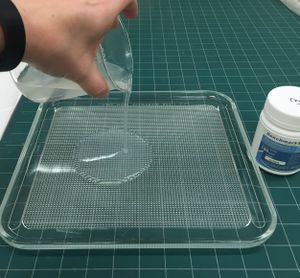 Making a thin layer of 3% agarose gel for use in removing water-based adhesive tape.